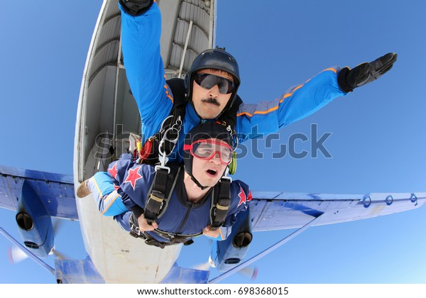 Tandem skydiving. Fist step in the sky.