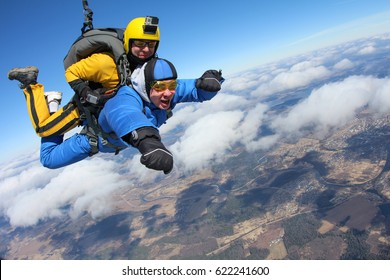 Tandem skydiving. Give me hand.