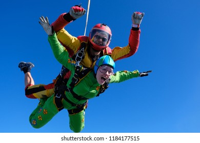 Tandem skydiving. Jump with pretty girl.