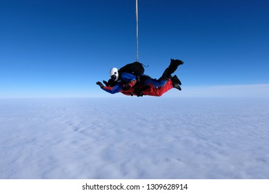 Tandem skydiving. Side view.