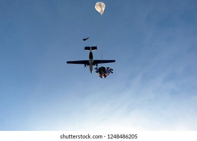 Tandem skydiving. Skydivers have just jumped out of a plane.
