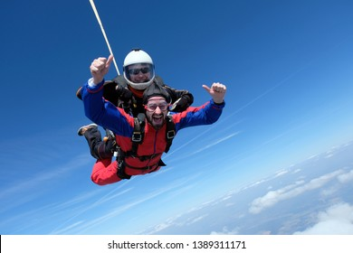 Tandem skydiving. Two men are flying in the sky.