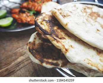 Tandoori chicken bbq and naan bread Indian food