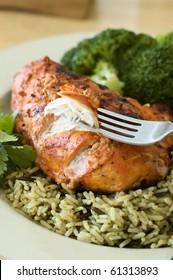 Tandoori Chicken Breast Dinner Being Eaten with a Fork
