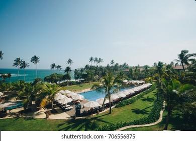 TANGALLE, SOUTHERN PROVINCE, SRI LANKA - APRIL 27, 2017: The Anantara beach haven resort swimming pool in Tangalle, Sri Lanka