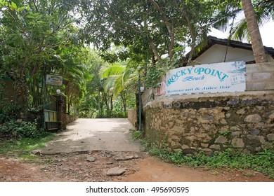 TANGALLE, SRI LANKA, ASIA - DECEMBER 12, 2014: Sign for Rocky Point where dirt road meets asphalt on December 12, 2014 in Tangalle, Sri Lanka, Asia.
