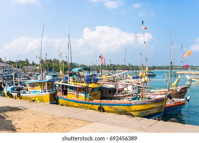 TANGALLE, SRI LANKA - DECEMBER 12. Colourful an picturesque fishing fleet at anchor in the harbor of Tangalle on December 12, 2016. The town is a regionally important fishing port in the south
