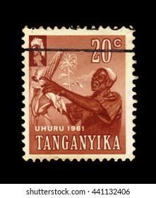 TANGANYIKA - CIRCA 1961: a stamp printed in Tanganyika shows Harvesting Corn, circa 1961