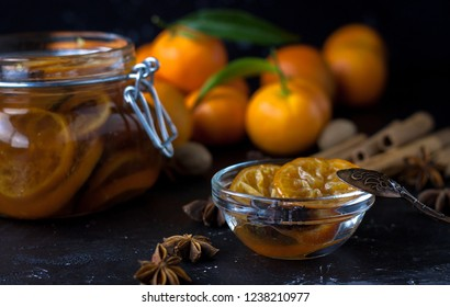 tangarine marmalade jam in glass jar. dark food photo style. Christmas winter or autumn mood. Homemade citrus cinnamon and anise stars marmalade