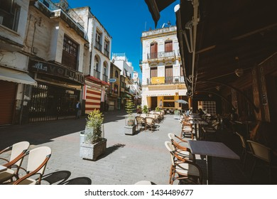 TANGER, MOROCCO - MAY 12, 2019: central square in the old Medina of Tanger, called Petit Socco, with famouse caffè house like the Cafè centrale and café Tingis
