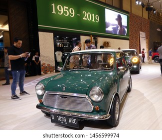 Tangerang, Banten, Indonesia - July 19, 2019. Mini shows their old Cooper and the latest in Gaikindo Indonesia International Auto Show (GIIAS) 2019 due to their 60th anniversary