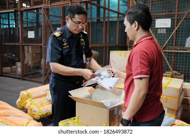 Tangerang, Banten-2016: A customs officer does physical examination imported goods at a temporary storage in Banten. Customs role is very important to prevent the entrance of illegal/prohibited goods.