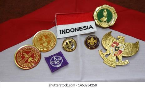 "Tangerang, Indonesia - July 28, 2015: Close Up of Indonesian Boys & Girl Scouts (Pramuka) Attributes Called ""Tunas kelapa"" and National emblem of Indonesia (Garuda Pancasila)."