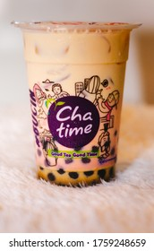 Tangerang, Indonesia - May 5th, 2020: An illustrative editorial of the Brown Sugar Fresh Milk Tea drink from the Chatime franchise with a side view of the logo.