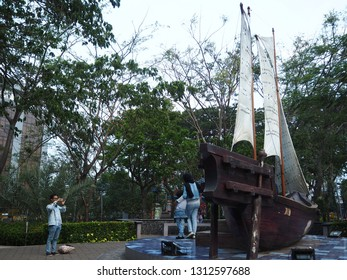 Tangerang, Indonesia - October 19, 2018: A family taking photos in front of the phinisi boat replica at Taman Potret.