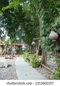 Tangerang, Indonesia - October 19, 2018: A walkway at Taman Bambu (Bamboo Park).