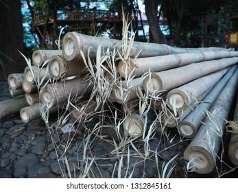 Tangerang, Indonesia - October 19, 2018: A pile of bamboo sticks lay on the ground at Taman Bambu.