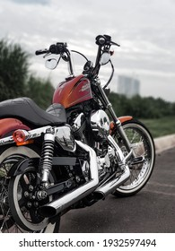 TANGERANG SELATAN, INDONESIA - January 17th, 2021 -  A Harley Davidson Motorcycle with red candy custom color and also chrome engine
