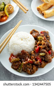 Tangerine beef with red peppers and rice