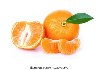 Tangerine or clementine orange fruit with green leaf and slices isolated on white background.