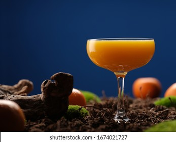 Tangerine cocktail on a blue background