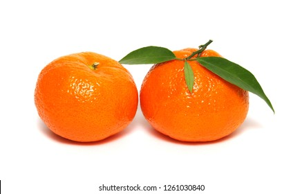 Tangerine with green leaf isolated on white background