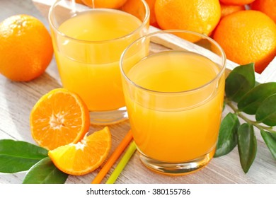 Tangerine juice and fresh ripe fruit