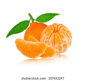 Tangerine with leaves and slices isolated on white