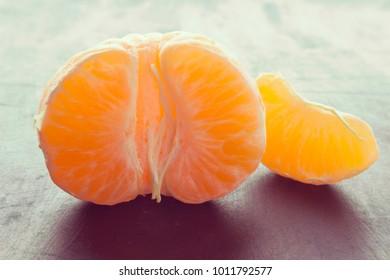 Tangerine or mandarin fruit- peeled half and slice