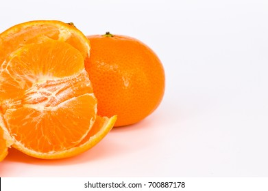 a tangerine or mandarin peeled on white background. Selective focus.