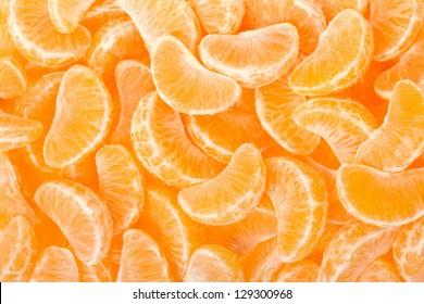 Tangerine segments, orange background texture