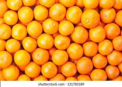 Tangerines as the background. Big bunch of ripe tangerines.
