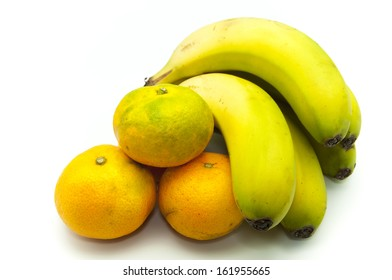 tangerines and bananas on a white background