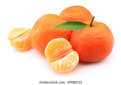 Tangerines entirely and segments and with leaves close up