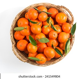 tangerines with green leaves in a basket isolated on white, isolated on a white, top view