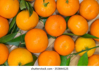 Tangerines with green leaves on a light background