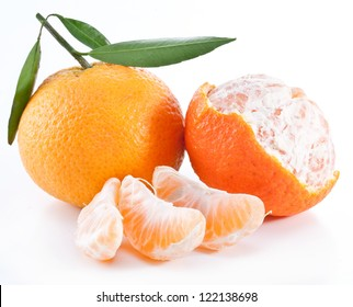 Tangerines with leaves on a white background.