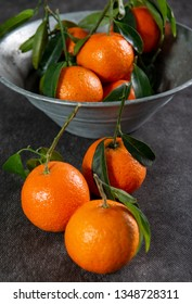 tangerines, mandarins, clementines, citrus fruits with the leaves