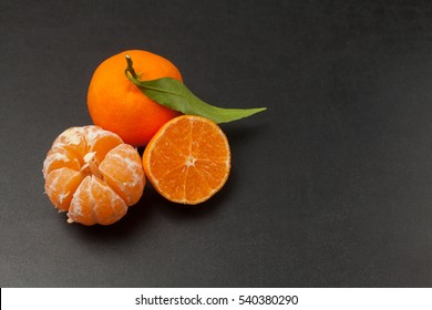Tangerines on black background