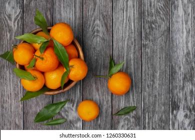Tangerines on dark wooden background.