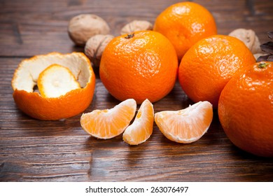 Tangerines on old wooden table