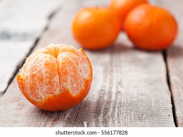 tangerines on a white wooden table close up