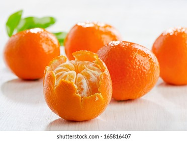 Tangerines on  wooden table. Selective focus