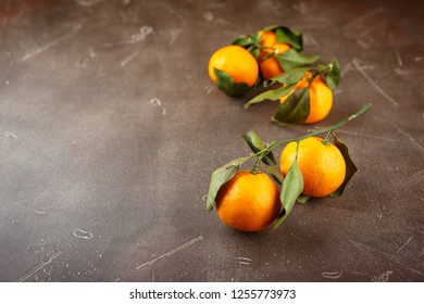 Tangerines - oranges, mandarins, clementines, citrus fruits with leaves. Copy space