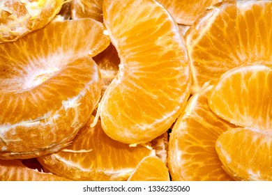 tangerines peeled from the skin filling the whole background