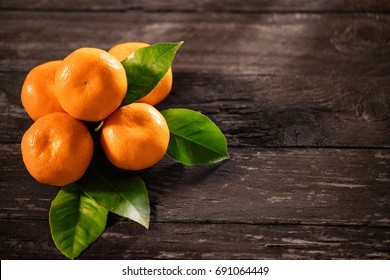 Tangerines top view on a wooden background. Background tangerines- Mandarins