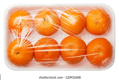 tangerines in vacuum packing isolated on white background