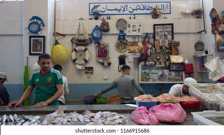 "Tangier, Morocco; July 7, 2018: Fishmongers in the ""Central Fish Market"" of Tangier."