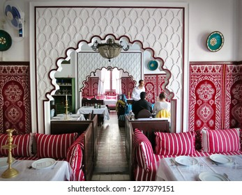 Tangier, Morocco - June 2016: Moroccan restaurant interior with lounge seats, tables, curtains