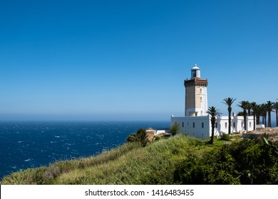 TANGIER, MOROCCO - MAY 12,2019 The isolated lighthouse of Cap Spartel in Morocco coast in front to Atlantic Ocean.